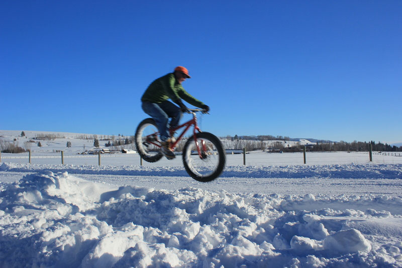 fat bike jumping on snow in winter