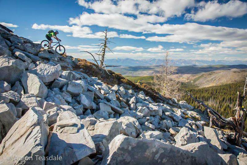 mountain biker down steep rocky trail