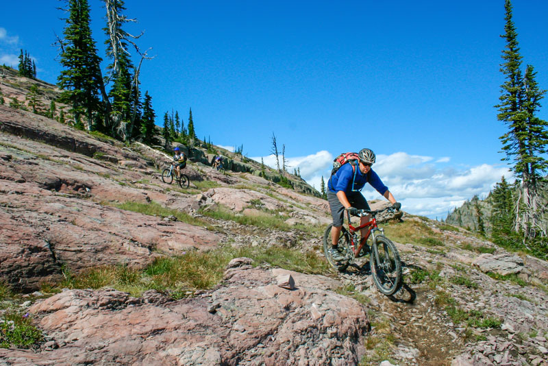 mountain biking down a rocky trail in norther montana