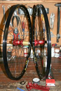 custom wheels on workbench showing hope hubs