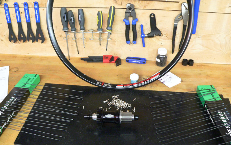 hand built wheel components on a workbench