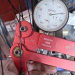 testing spoke tension on bike